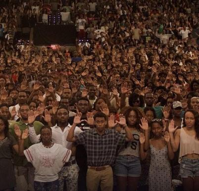 Howard University students posed in this photo in protest of the killing of Michael Brown. Image Courtesy | Twitter user @The_Blackness48